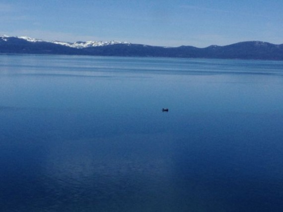 small boat alone in wintery Lake Tahoe