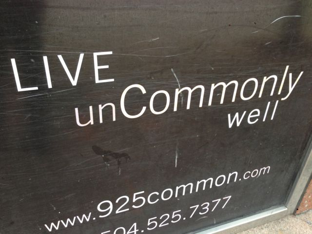 live uncommonly well sign