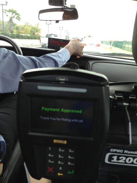 paying my cab fare while waiting in traffic at Louis Armstrong New Orleans International airport