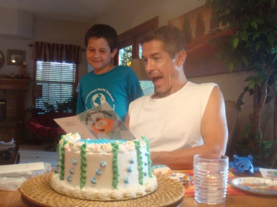 Dad making big surprised face after opening young Son's birthday card