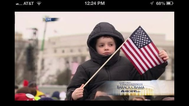 A boy and an American Flag on Inauguration day