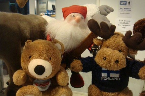 jeff noel's famous teddy bear with other stuffed animals in Finland store