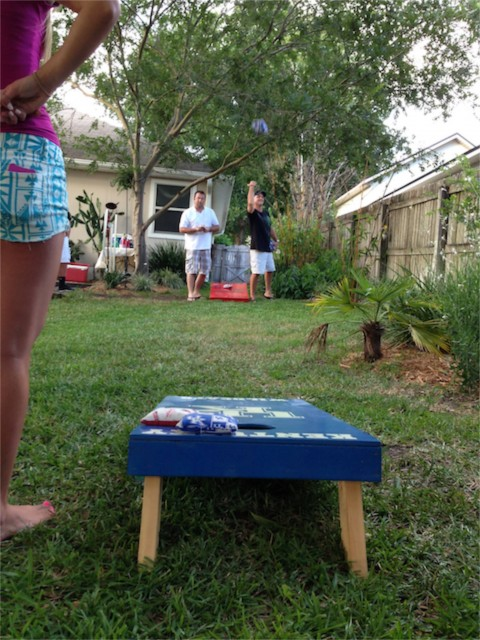 Back yard corn hole game