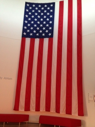 Giant American flag hanging on wall