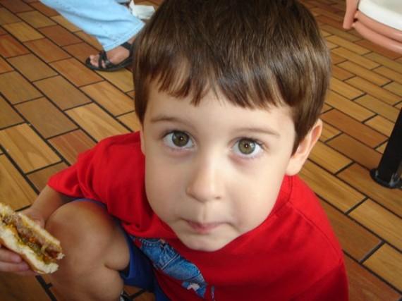 Young, hopeful boy staring at camera