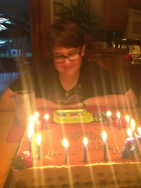teenager after blowing out 13 birthday candles