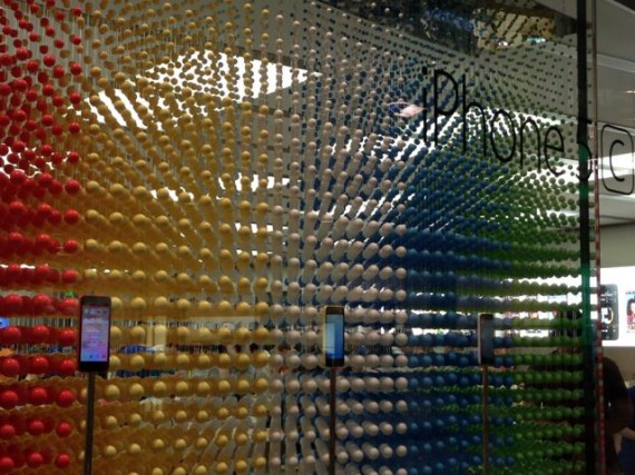 Apple Store window display of colorful beads promoting iPhone 5c
