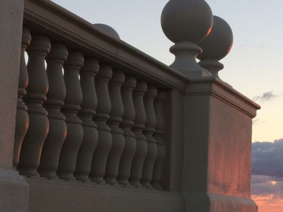 The very fist golden rays of the sun barley touching the railing pillars