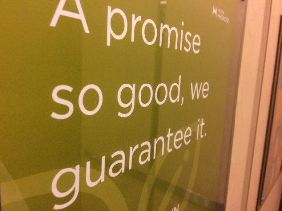 Sign with bold promise in hotel elevator