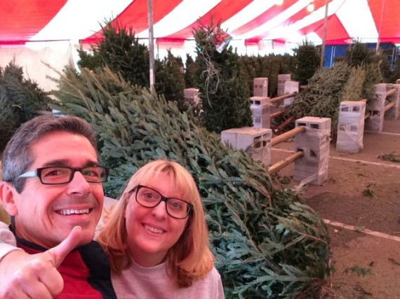 happy couple buying Christmas tree in Orlando