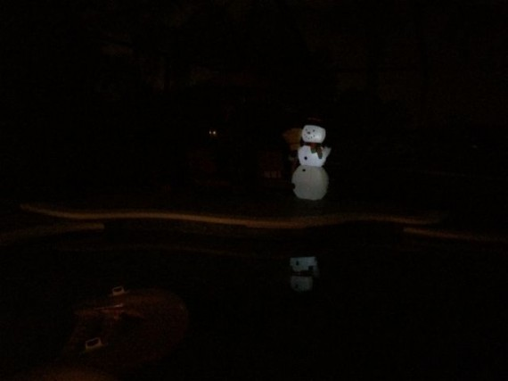 Inflatable snowman at night on pool deck