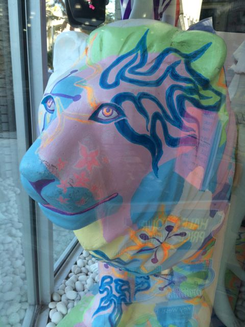 Colorful lion figure in South Beach store front window