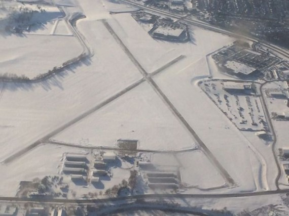 small Iowa airpot covered in snow, ariel view