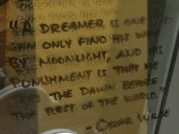 Oscar Wilde quote on office door grease board
