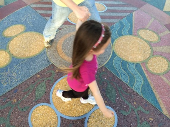 Small child at Disneyland entrance compass