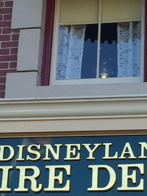 Walt Disney's Apartment window lamp light above Disneyland's Firestation
