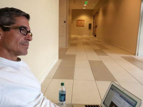 jeff noel sitting on Church hallway floor