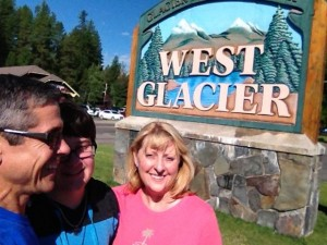 Family in front of West Glacier sign
