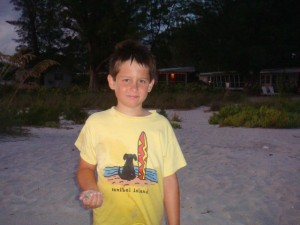 Young boy on annual Summer trip to Sanibel Island
