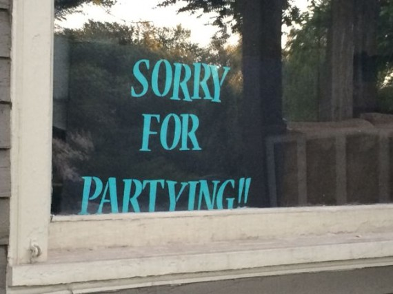 Sorry For partying sign in campus apartment window