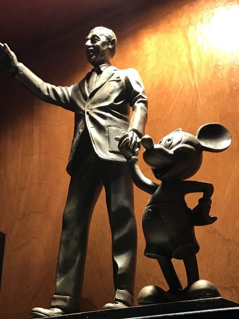Walt Disney Partners statue on bookshelf