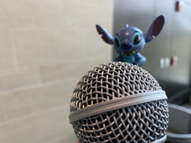 Stitch at a microphone