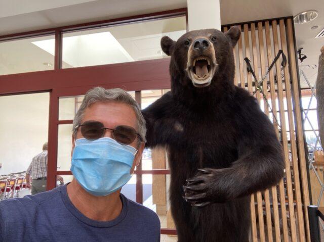 Jeff noel next to stuffed Grizzly Bear