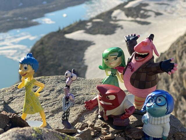 Pixar Inside Out figurines in mountain setting