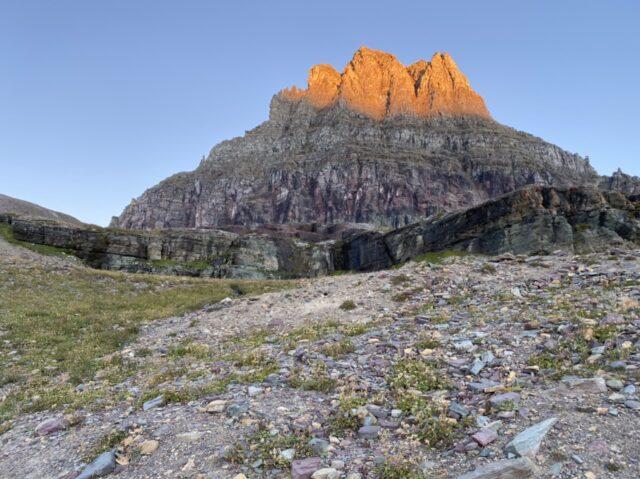 Mountain with sunrise sunlight hitting mountain top