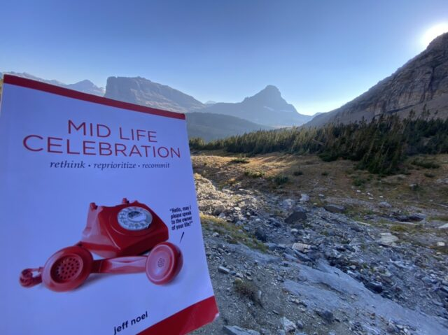 Mid Life Celebration, the book, with mountains in the background