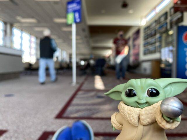 baby yoda toy at airport