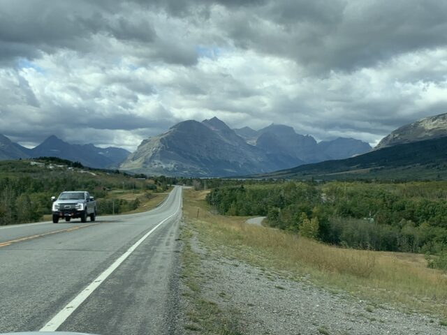 Highway leading to a mountain range