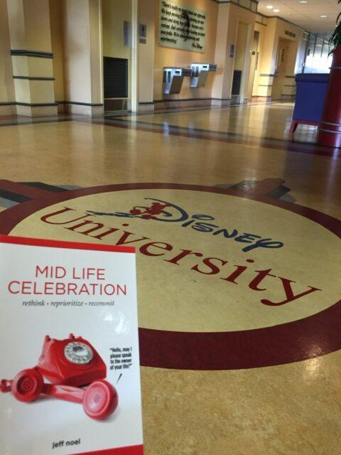 The book Mid Life Celebration at Disney University lobby