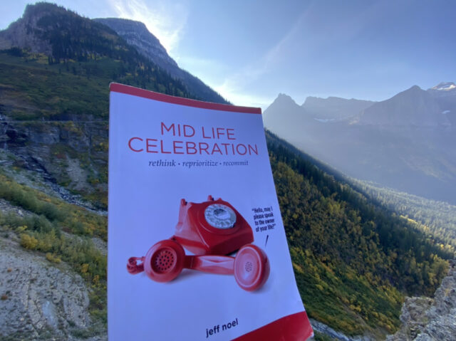 The book mid life celebration in a mountain backdrop