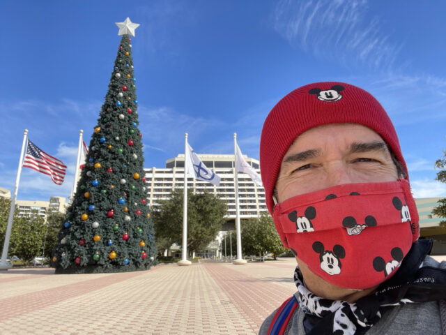 Man in a Disney mask and Disney hat at contemporary resort