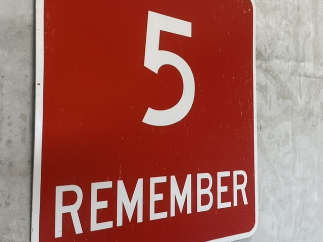 red sign with number 5 and the word remember