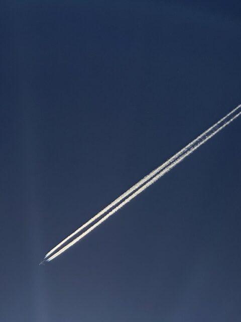 jet streaking across deep blue sky