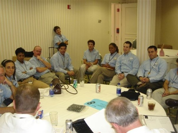 Team of 14 gathered around a table