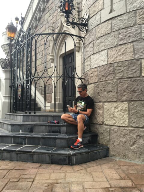 Disney Speaker Jeff Noel writing a book on Cinderella Castle steps